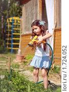Купить «Девочка поливает огород», фото № 1724052, снято 23 мая 2010 г. (c) Papoyan Irina / Фотобанк Лори