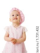Купить «Маленькая девочка смотрит вверх», фото № 1731432, снято 5 мая 2009 г. (c) Ольга Сапегина / Фотобанк Лори