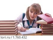 Купить «Старшеклассница на экзамене подсматривает в книгу», фото № 1760432, снято 26 мая 2010 г. (c) Ирина Карлова / Фотобанк Лори