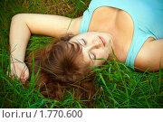 Купить «Девушка лежит в траве», фото № 1770600, снято 16 мая 2010 г. (c) Анна Лурье / Фотобанк Лори