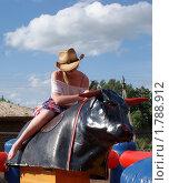 Девушка ковбой на механическом быке. Стоковое фото, фотограф Галина Гаврилова / Фотобанк Лори