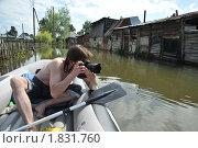 Купить «Фотокорреспондент снимает наводнение», фото № 1831760, снято 26 июня 2010 г. (c) Free Wind / Фотобанк Лори