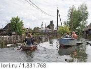 Купить «Лодочное движение по затопленной улице», фото № 1831768, снято 26 июня 2010 г. (c) Free Wind / Фотобанк Лори