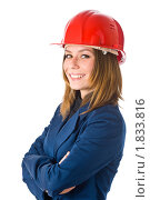 Молодая женщина-строитель, изолированная на белом фоне. Стоковое фото, фотограф Игорь Губарев / Фотобанк Лори