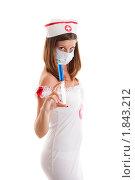 Купить «Девушка в костюме медсестры со шприцем», фото № 1843212, снято 6 июня 2010 г. (c) Сергей Дубров / Фотобанк Лори