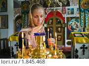 Купить «Девушка ставит свечку в православном храме», фото № 1845468, снято 14 июля 2010 г. (c) Андрей Ярославцев / Фотобанк Лори