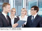 Купить «Команда бизнесменов в офисе», фото № 1853036, снято 17 июня 2010 г. (c) Raev Denis / Фотобанк Лори