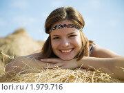 Купить «Девушка лежит на сене», фото № 1979716, снято 14 сентября 2010 г. (c) Яков Филимонов / Фотобанк Лори