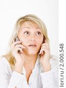 Купить «Девушка говорит по двум телефонам сразу», фото № 2000548, снято 24 октября 2009 г. (c) Татьяна Гришина / Фотобанк Лори