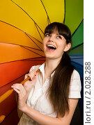 Купить «Брюнетка под разноцветным зонтом», фото № 2028288, снято 24 ноября 2009 г. (c) Losevsky Pavel / Фотобанк Лори