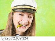 Купить «Девушка матрос с соленым огурчиком», фото № 2039224, снято 30 января 2010 г. (c) Яков Филимонов / Фотобанк Лори