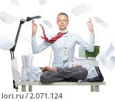 Купить «Девушка в позе лотоса на рабочем столе», фото № 2071124, снято 14 августа 2010 г. (c) Сергей Новиков / Фотобанк Лори