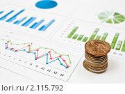 Купить «Монеты на финансовых графиках», фото № 2115792, снято 2 октября 2010 г. (c) Сергей Дашкевич / Фотобанк Лори