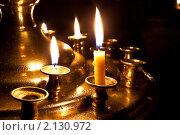Купить «Церковный подсвечник с горящими свечами  в ночном храме», фото № 2130972, снято 8 ноября 2010 г. (c) Андрей Ярославцев / Фотобанк Лори