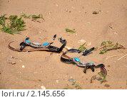 Босоножки в песке. Стоковое фото, фотограф Евгений Безгодов / Фотобанк Лори