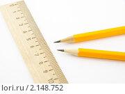 Купить «Два карандаша и деревянная линейка на белом фоне», фото № 2148752, снято 1 апреля 2010 г. (c) Рустам Шигапов / Фотобанк Лори
