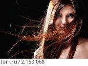 Купить «Девушка с длинными развевающимися волосами на черном фоне», фото № 2153068, снято 28 октября 2010 г. (c) Raev Denis / Фотобанк Лори
