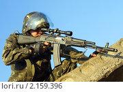 Купить «Снайпер в камуфляже», фото № 2159396, снято 28 июля 2009 г. (c) Сергей Сухоруков / Фотобанк Лори