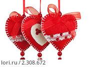 Купить «Три валентинки из ткани ко Дню Святого Валентина», фото № 2308672, снято 27 января 2011 г. (c) Оксана Гильман / Фотобанк Лори