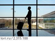 Купить «Мужчина в аэропорту», фото № 2315188, снято 11 апреля 2010 г. (c) Losevsky Pavel / Фотобанк Лори
