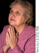 Купить «Женщина молится», фото № 2372768, снято 19 февраля 2011 г. (c) Воронин Владимир Сергеевич / Фотобанк Лори