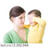 Купить «Молодая женщина с плачущим малышом на руках», фото № 2392044, снято 10 февраля 2011 г. (c) Svetlana Mihailova / Фотобанк Лори