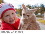 Купить «Девочка с рыжим котом», фото № 2444064, снято 10 октября 2010 г. (c) LenaLeonovich / Фотобанк Лори