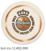 Купить «Подставка под пивную кружку с рекламой пива Варштайнер (Warsteiner Brauerei)», фото № 2492000, снято 16 сентября 2019 г. (c) Юрий Кобзев / Фотобанк Лори