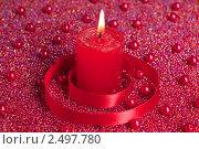 Горящая красная свеча. Стоковое фото, фотограф Виктория Кононова / Фотобанк Лори