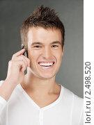 Купить «Молодой человек говорит по мобильному телефону», фото № 2498520, снято 10 ноября 2010 г. (c) BestPhotoStudio / Фотобанк Лори