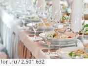 Купить «Сервированный стол в ресторане», фото № 2501632, снято 24 августа 2019 г. (c) Дмитрий Калиновский / Фотобанк Лори