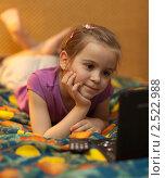 Купить «Девочка смотрит мультики на двд-проигрывателе», фото № 2522988, снято 29 апреля 2011 г. (c) Антон Балаж / Фотобанк Лори