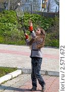 Купить «Девочка играет в бадминтон», фото № 2571672, снято 2 июня 2011 г. (c) RedTC / Фотобанк Лори