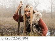 Купить «Девушка-викинг с мечом в лесу», фото № 2590804, снято 11 мая 2011 г. (c) Дмитрий Черевко / Фотобанк Лори