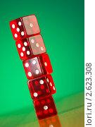 Купить «Красные кости на зеленом фоне», фото № 2623308, снято 28 января 2010 г. (c) Elnur / Фотобанк Лори