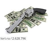 Купить «Модель кольта на  долларах на белом фоне», иллюстрация № 2628796 (c) Владимир Чернов / Фотобанк Лори