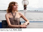 Купить «Красивая девушка за столиком кафе», фото № 2709368, снято 17 июля 2011 г. (c) Кекяляйнен Андрей / Фотобанк Лори