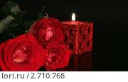 Купить «Горящая свеча и красная роза на черном фоне», видеоролик № 2710768, снято 7 марта 2010 г. (c) ILLYCH / Фотобанк Лори