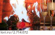 Купить «Два фужера с шампанским на фоне камина», видеоролик № 2714072, снято 3 августа 2011 г. (c) ILLYCH / Фотобанк Лори