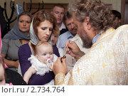 Купить «Крещение младенца», фото № 2734764, снято 16 июля 2011 г. (c) Кекяляйнен Андрей / Фотобанк Лори