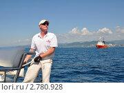 Купить «Матрос яхты Scorpius готовится к швартовке», фото № 2780928, снято 7 сентября 2011 г. (c) Анна Мартынова / Фотобанк Лори