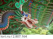 Купить «Голова дракона на буддистском храме. Корея.», эксклюзивное фото № 2807164, снято 12 сентября 2011 г. (c) Ольга Липунова / Фотобанк Лори