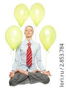 Купить «Девушка в позе йоги с привязанными воздушными шариками», фото № 2853784, снято 15 мая 2011 г. (c) Сергей Новиков / Фотобанк Лори