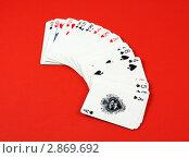 Купить «Игральные карты на красном фоне», фото № 2869692, снято 1 марта 2008 г. (c) Georgios Kollidas / Фотобанк Лори
