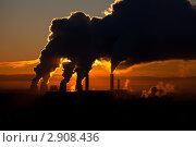 Купить «Трубы ТЭЦ с дымом на фоне оранжевого неба», фото № 2908436, снято 1 декабря 2010 г. (c) Александр Косарев / Фотобанк Лори