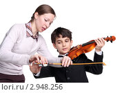 Обучение игре на скрипке. Учитель и ученик. Стоковое фото, фотограф lanych / Фотобанк Лори