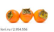 Купить «Три спелые хурмы на белом фоне», фото № 2954556, снято 15 ноября 2011 г. (c) Ласточкин Евгений / Фотобанк Лори