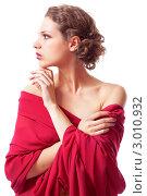 Портрет сексуальной молодой девушки в красном платье, белый фон. Стоковое фото, фотограф Serg Zastavkin / Фотобанк Лори