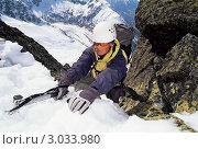 Купить «Альпинист с помощью ледоруба поднимается по крутому склону в горах», фото № 3033980, снято 15 августа 2018 г. (c) Monkey Business Images / Фотобанк Лори