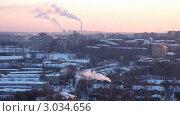 Купить «Вид на теплоэлектростанцию и зимний город», видеоролик № 3034656, снято 23 февраля 2011 г. (c) Гурьянов Андрей / Фотобанк Лори